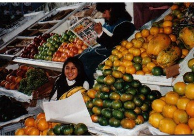 12  a candid warm smile amongst the rich fruit harvest! 1