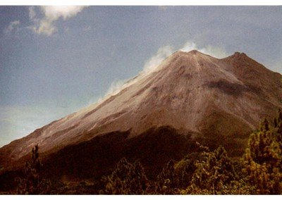 12b  Mount Arenal darkens and fumes, spitting loud rocks